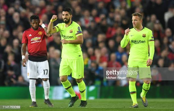 Luis Suarez of Barcelona celebrates his sides first goal, an own goal by Manchester United's Luke Shaw, during the UEFA Champions League Quarter...