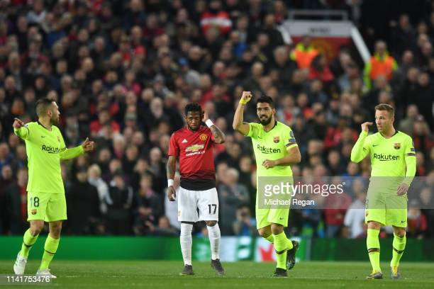 Luis Suarez of Barcelona celebrates his sides first goal an own goal by Manchester United's Luke Shaw during the UEFA Champions League Quarter Final...