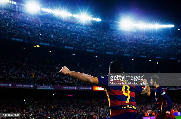 Luis Suarez of Barcelona celebrates his team's second goal scored by Gerard Pique during the La Liga match between FC Barcelona and Sevilla FC at...