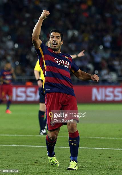 Luis Suarez of Barcelona celebrates scores their fourth goal during the UEFA Super Cup during the UEFA Super Cup match between Barcelona and Sevilla...