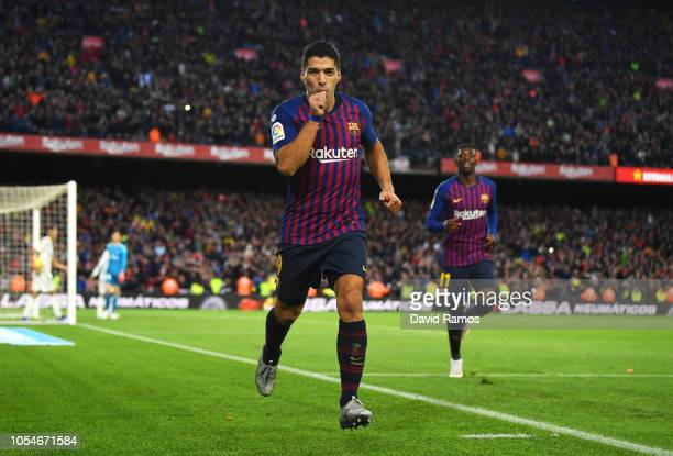 Luis Suarez of Barcelona celebrates scoring his sides fourth goal and completes his hat trick during the La Liga match between FC Barcelona and Real...
