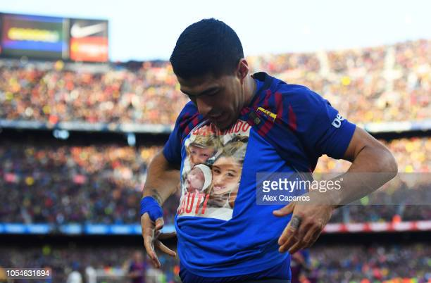 Luis Suarez of Barcelona celebrates scoring his sides second goal from a penalty during the La Liga match between FC Barcelona and Real Madrid CF at...