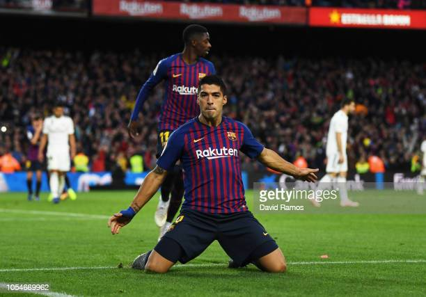Luis Suarez of Barcelona celebrates scoring his sides third goal during the La Liga match between FC Barcelona and Real Madrid CF at Camp Nou on...