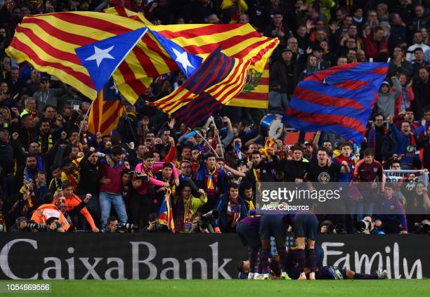 Luis Suarez of Barcelona celebrates scoring his sides third goal with team mates and fans during the La Liga match between FC Barcelona and Real...