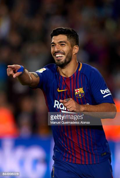 Luis Suarez of Barcelona celebrates scoring his team's fifth goal during the La Liga match between Barcelona and Espanyol at Camp Nou on September 9...