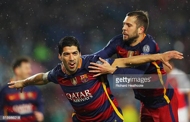 Luis Suarez of Barcelona celebrates scoring his team's second goal with his team mate Jordi Alba during the UEFA Champions League round of 16 second...