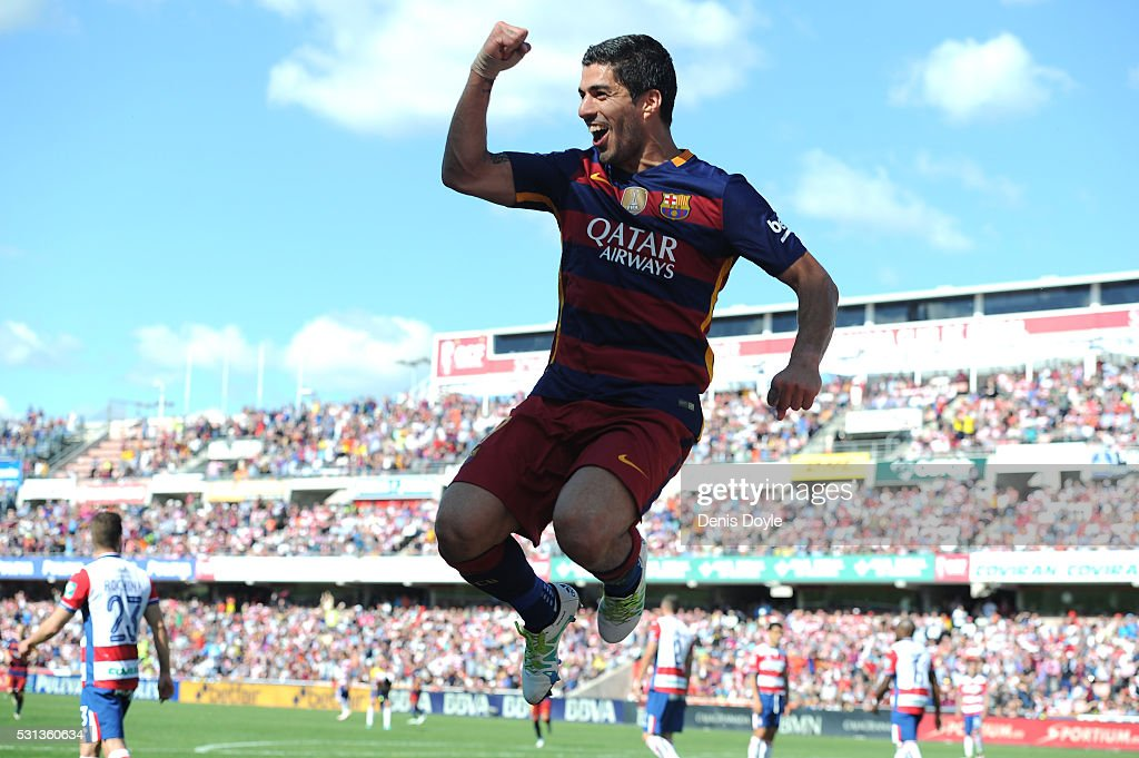 Luis Suarez of Barcelona celebrates scoring his team's second goal during the La Liga match between Granada and Barcelona at Estadio Nuevo Los Carmenes on May 14, 2016 in Granada, Spain.