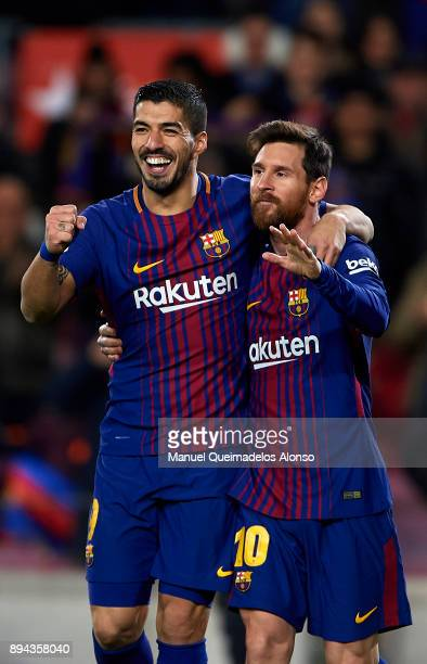 Luis Suarez of Barcelona celebrates scoring his team's third goal with his teammate Lionel Messi during the La Liga match between Barcelona and...