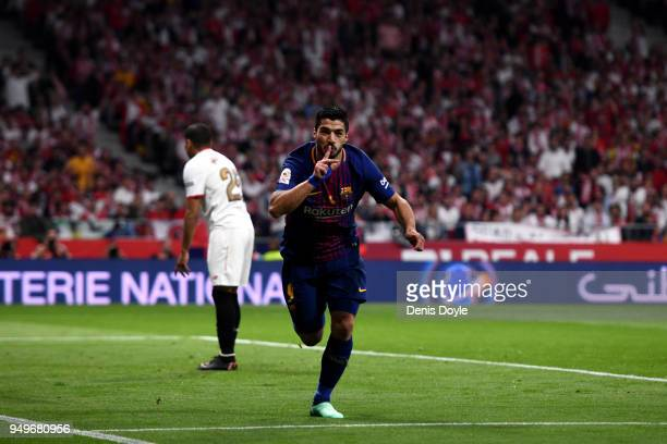 Luis Suarez of Barcelona celebrates scoring the first goal of the game during the Spanish Copa del Rey match between Barcelona and Sevilla at Wanda...