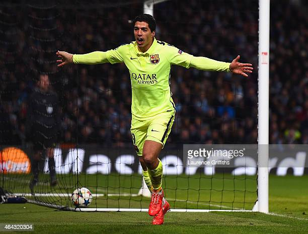 Luis Suarez of Barcelona celebrates scoring their second goal during the UEFA Champions League Round of 16 match between Manchester City and...