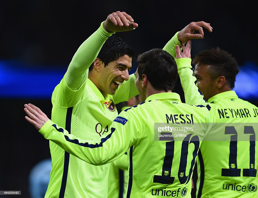 Luis Suarez of Barcelona (L) celebrates scoring their second goal with Lionel Messi and Neymar of Barcelona during the UEFA Champions League Round of 16 match between Manchester City and Barcelona at Etihad Stadium on February 24, 2015 in Manchester, United Kingdom.