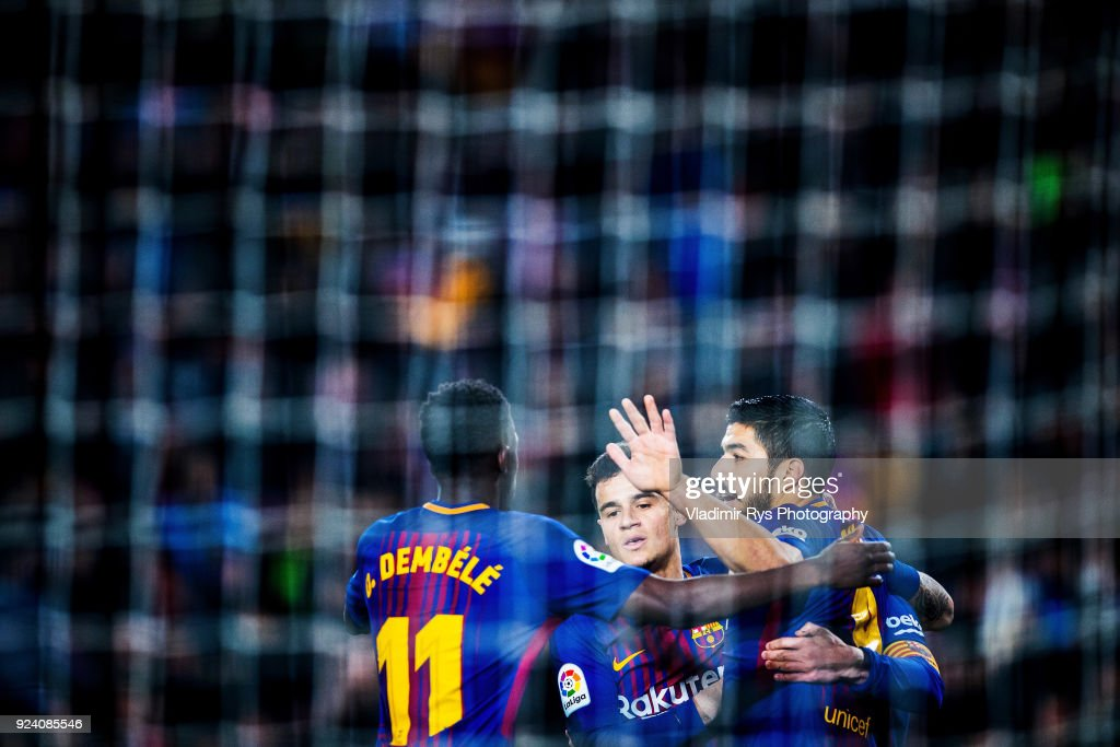 Luis Suarez of Barcelona celebrates with his team mates after scoring his team's first goal during the La Liga match between FC Barcelona and Girona at the Camp Nou stadium on February 24, 2018 in Barcelona, Spain.