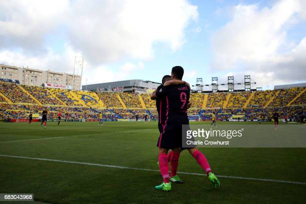Luis Suarez of Barcelona celebrates with Jordi Alba after scoring the team's second goal of the game during the La Liga match between UD Las Palmas...