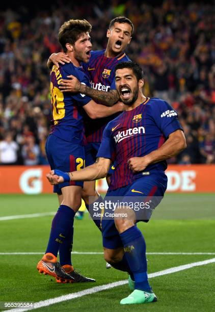 Luis Suarez of Barcelona celebrates with Sergi Roberto and Philippe Coutinho as he scores his sides first goal during the La Liga match between...
