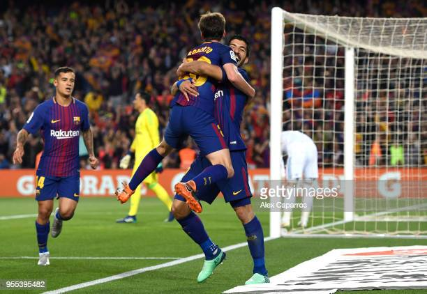 Luis Suarez of Barcelona celebrates with Sergi Roberto of Barcelona as he scores his sides first goal during the La Liga match between Barcelona and...