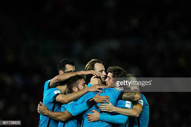 Luis Suarez of Barcelona celebrates with team mates after scoring his team's third goal with a penalty during the FIFA Club World Cup Semi Final...