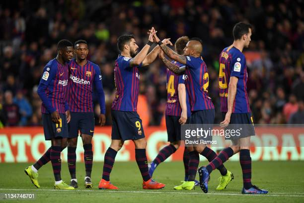 Luis Suarez of Barcelona celebrates with teammate Arturo Vidal after scoring his team's third goal during the La Liga match between FC Barcelona and...