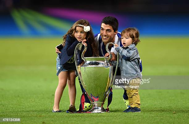 Luis Suarez of Barcelona celebrates with the trophy and daughter Delfina and son Benjamin after the UEFA Champions League Final between Juventus and...
