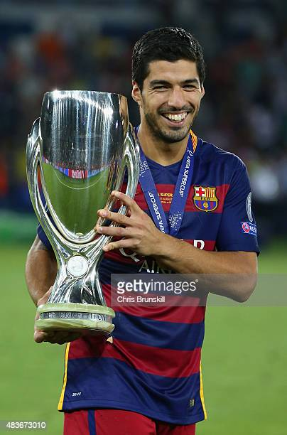 Luis Suarez of Barcelona celebrates with the UEFA Super Cup after the UEFA Super Cup between Barcelona and Sevilla FC at Dinamo Arena on August 11...