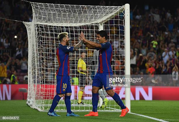 Luis Suarez of Barcelona celebretes scoring his sides seventh goal with Lionel Messi of Barcelona during the UEFA Champions League Group C match...