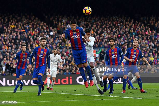 Luis Suarez of Barcelona clears the ball during the La Liga match between FC Barcelona and Real Madrid CF at Camp Nou on December 3 2016 in Barcelona...