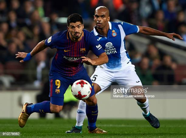 Luis Suarez of Barcelona competes for the ball with Edinaldo Gomes Pereira of Espanyol during the Spanish Copa del Rey Quarter Final Second Leg match...