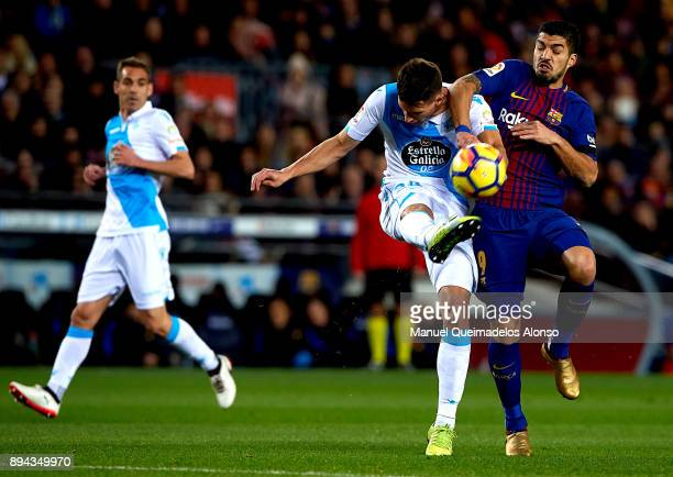 Luis Suarez of Barcelona competes for the ball with Fabian Schar of Deportivo de La Coruna during the La Liga match between Barcelona and Deportivo...