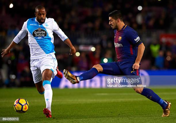 Luis Suarez of Barcelona competes for the ball with Sidnei Rechel of Deportivo de La Coruna during the La Liga match between Barcelona and Deportivo...