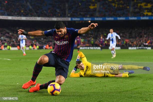 Luis Suarez of Barcelona falls after a challenge by Ivan Cuellar of Leganes during the La Liga match between FC Barcelona and CD Leganes at Camp Nou...