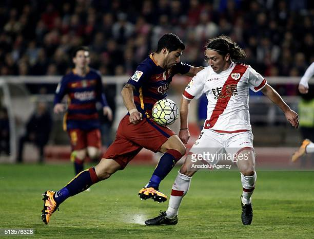 Luis Suarez of Barcelona in action against Diego Llorente of Rayo Vallecano during the Spanish football league match between FC Barcelona and Rayo...