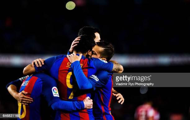Luis Suarez of Barcelona is celebrated by his team mates Lionel Messi and Jordi Alba after scoring his team's third goal during the La Liga match...
