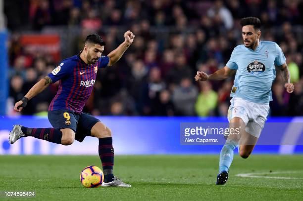 Luis Suarez of Barcelona is challenged by David Costas of Celta Vigo during the La Liga match between FC Barcelona and RC Celta de Vigo at Camp Nou...