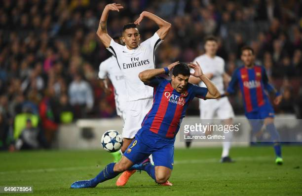 Luis Suarez of Barcelona is challenged by Marquinhos of PSG for a penalty during the UEFA Champions League Round of 16 second leg match between FC...