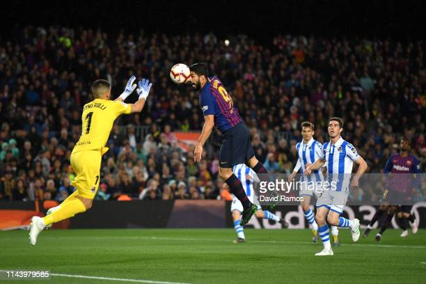 Luis Suarez of Barcelona misses a chance under pressure from Geronimo Rulli of Real Sociedad during the La Liga match between FC Barcelona and Real...