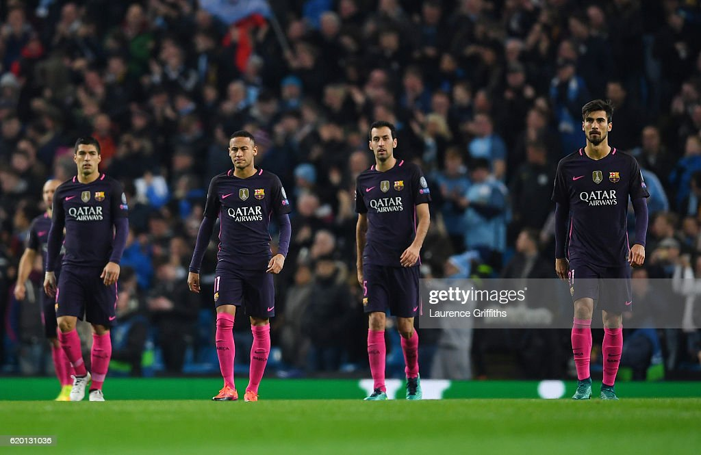 Luis Suarez of Barcelona, Neymar of Barcelona, Sergio Busquets of Barcelona and Andre Gomes of Barcelona are dejected after Kevin De Bruyne of Manchester City (not pictured) scores his sides second goal during the UEFA Champions League Group C match between Manchester City FC and FC Barcelona at Etihad Stadium on November 1, 2016 in Manchester, England.