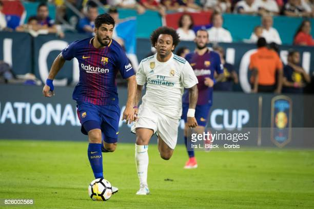 Luis Suarez of Barcelona out runs Marcelo of Real Madrid during the International Champions Cup El Clásico match between FC Barcelona and Real Madrid...