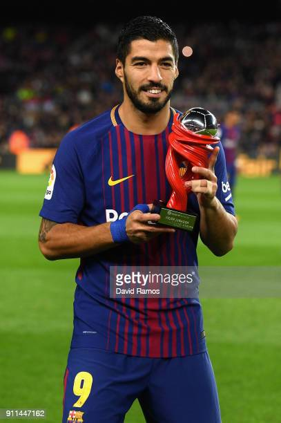 Luis Suarez of Barcelona poses with his La Liga player of the month award prior to the La Liga match between Barcelona and Deportivo Alaves at Camp...