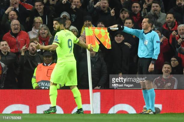 Luis Suarez of Barcelona reacts as the linesman signals for offside before VAR over rules his decision and Luis Suarez of Barcelona's first goal is...