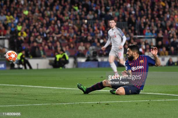 Luis Suarez of Barcelona scores his sides first goal during the UEFA Champions League Semi Final first leg match between Barcelona and Liverpool at...