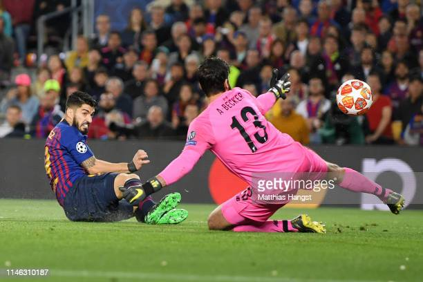Luis Suarez of Barcelona scores his sides first goal past Alisson of Liverpool during the UEFA Champions League Semi Final first leg match between...