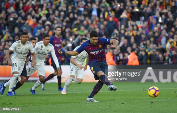 Luis Suarez of Barcelona scores his sides second goal from a penalty during the La Liga match between FC Barcelona and Real Madrid CF at Camp Nou on...