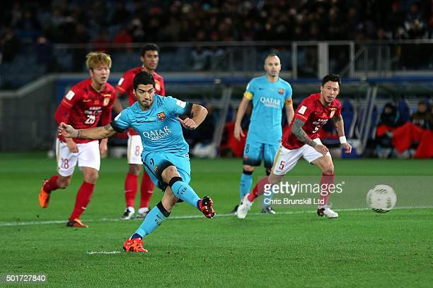 Luis Suarez of Barcelona scores his side's third goal from the penalty spot during the FIFA Club World Cup Semi Final match between Barcelona and...