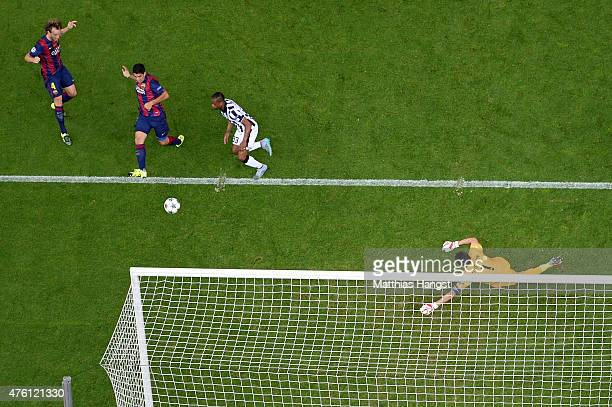 Luis Suarez of Barcelona scores his team's second goal past Gianluigi Buffon of Juventus during the UEFA Champions League Final between Juventus and...