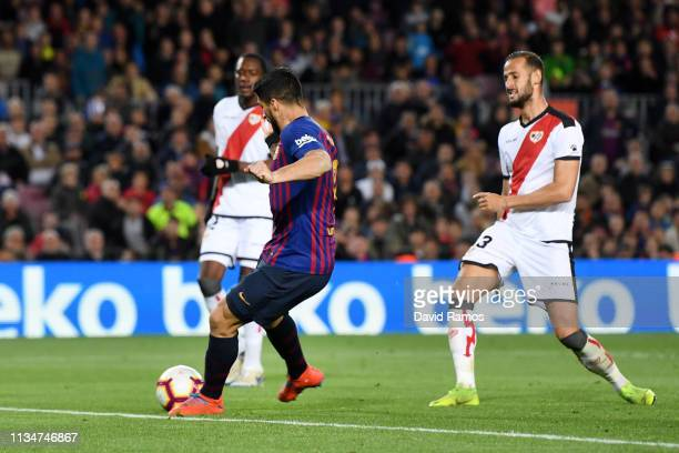 Luis Suarez of Barcelona scores his team's third goal from the penalty spot during the La Liga match between FC Barcelona and Rayo Vallecano de...