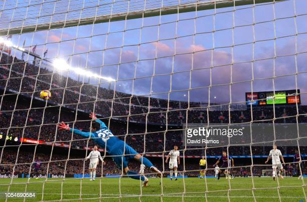 Luis Suarez of Barcelona scores sides third goal past Thibaut Courtois of Real Madrid during the La Liga match between FC Barcelona and Real Madrid...