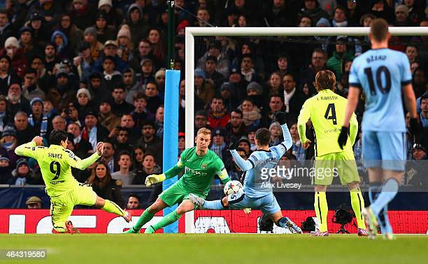 Luis Suarez of Barcelona scores their second goal past Joe Hart of Manchester City during the UEFA Champions League Round of 16 match between...