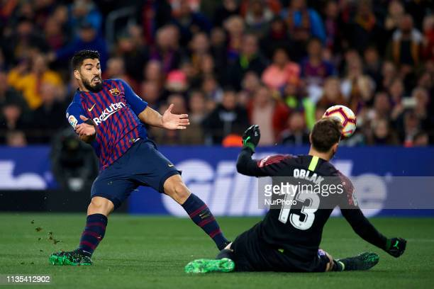 Luis Suarez of Barcelona shooting to goal and Jan Oblak of Atletico Madrid does stop the ball during the La Liga match between FC Barcelona and Club...