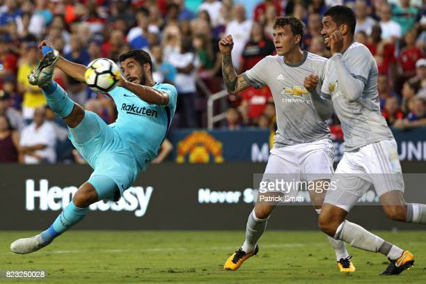 Luis Suarez of Barcelona shoots against Manchester United in the first half during the International Champions Cup match at FedExField on July 26...