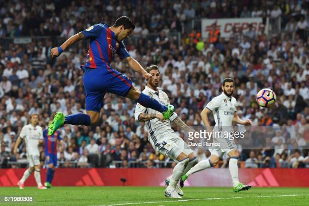 Luis Suarez of Barcelona shoots during the La Liga match between Real Madrid CF and FC Barcelona at Estadio Bernabeu on April 23 2017 in Madrid Spain