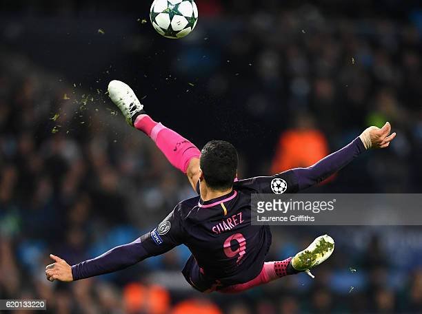 Luis Suarez of Barcelona volleys during the UEFA Champions League Group C match between Manchester City FC and FC Barcelona at Etihad Stadium on...